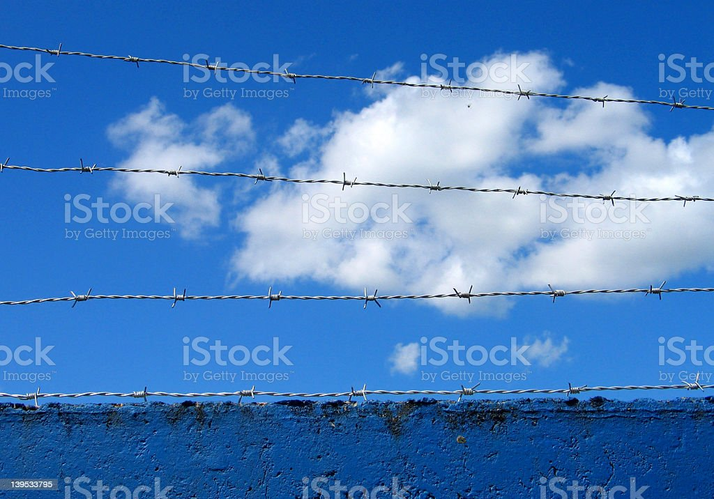 Barbwire on sky royalty-free stock photo