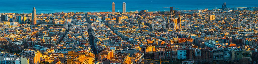 Barcelona aerial panorama over Mediterranean sunset landmarks Sagrada Familia Spain stock photo