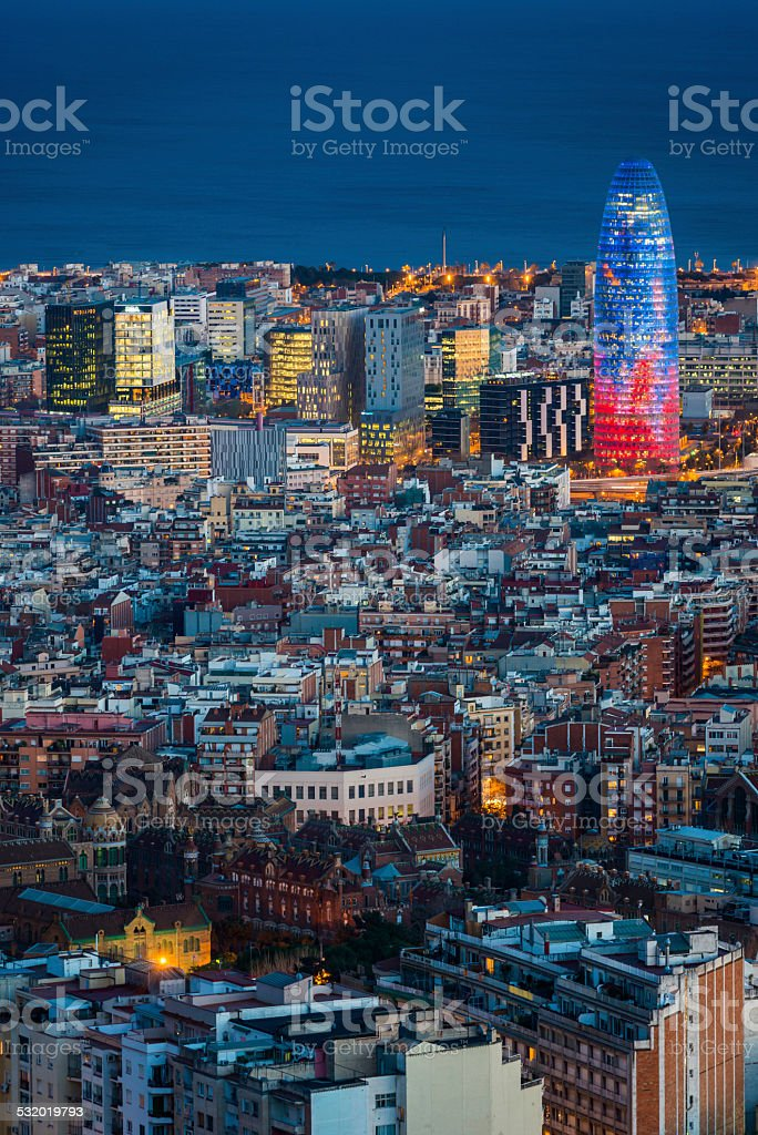 Barcelona aerial view over illuminated city rooftops Torre Agbar Spain stock photo