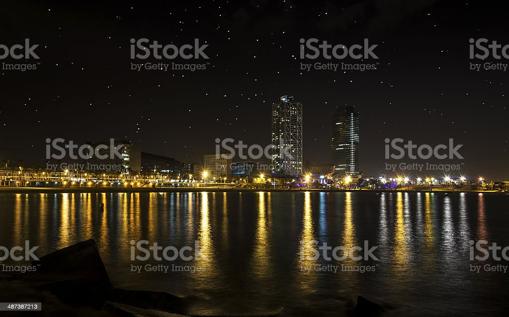 Barcelona by night from the sea stock photo