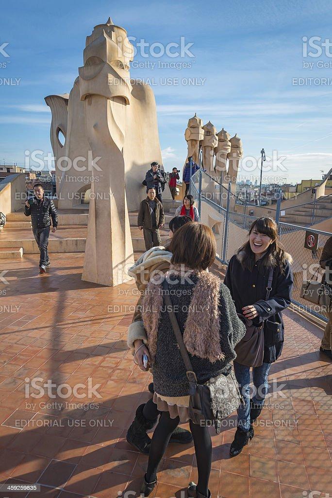 Barcelona Chinese tourists on La Pedrera Gaudi's Casa Mila Spain stock photo