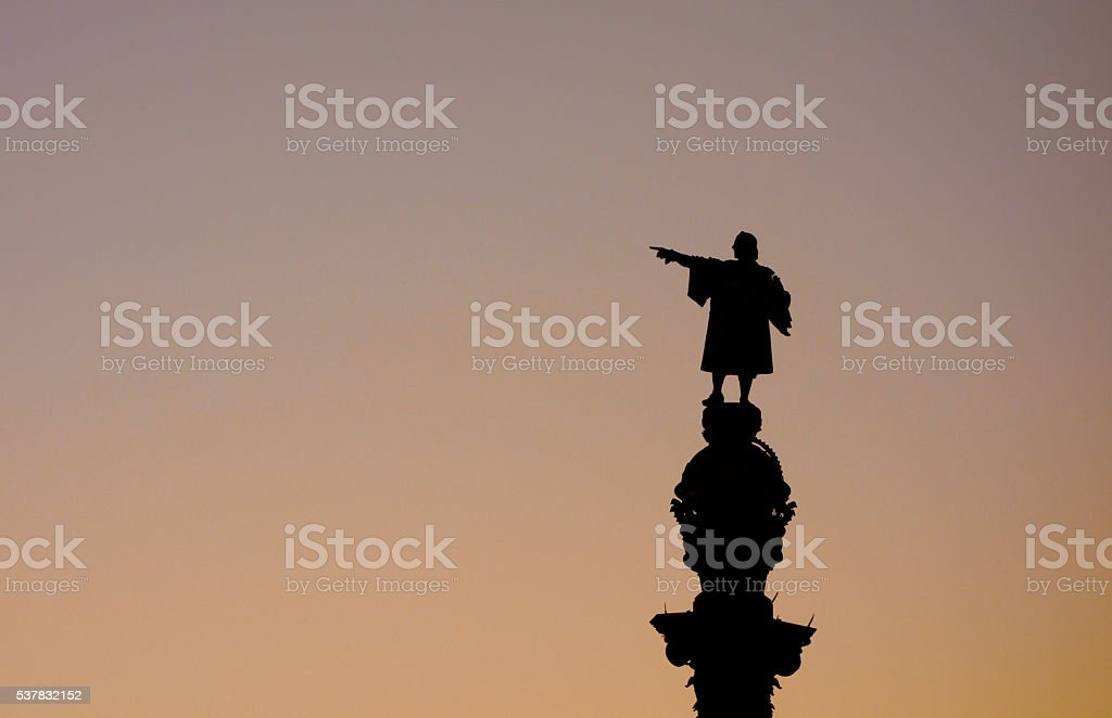 Barcelona Christopher Columbus statue silhouette over sunset clear sky stock photo