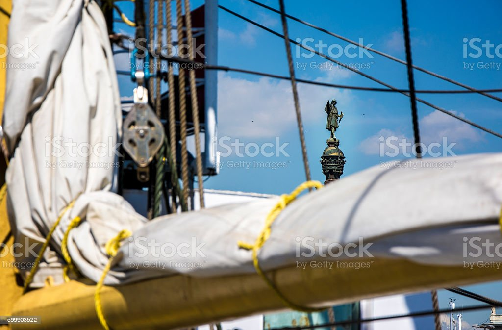 Barcelona Christopher Columbus statue viewed throug the rigging of a stock photo