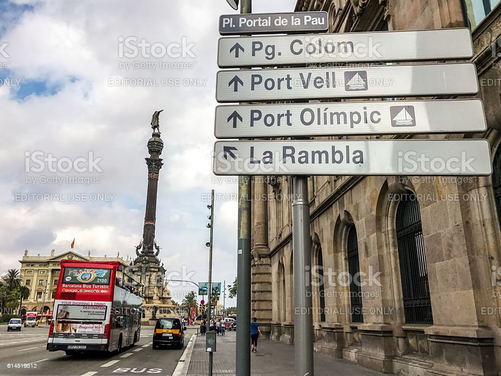 Barcelona directions signs and tour bus, Spain stock photo