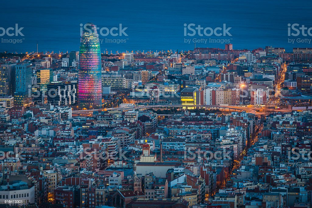 Barcelona downtown rooftops avenues and Mediterranean Ocean Torre Agbar Spain stock photo