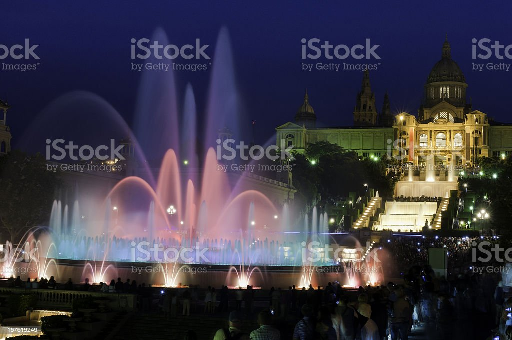 Barcelona Font Màgica MNAC tourists watching colorful fountain night Spain stock photo