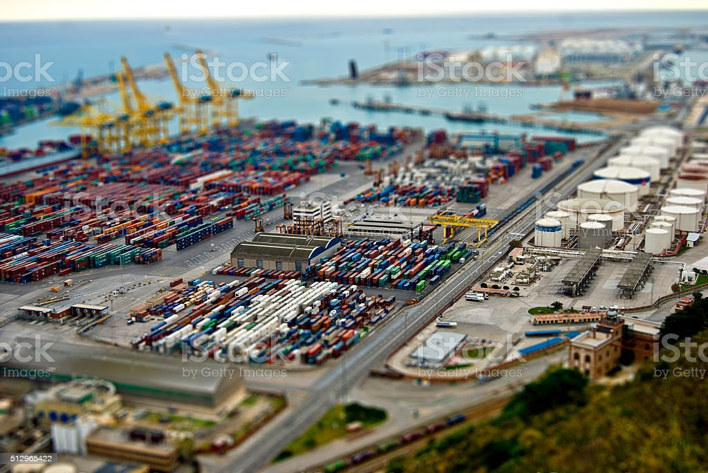 Barcelona harbour with cargo and factories. Tilt Shift Effect stock photo
