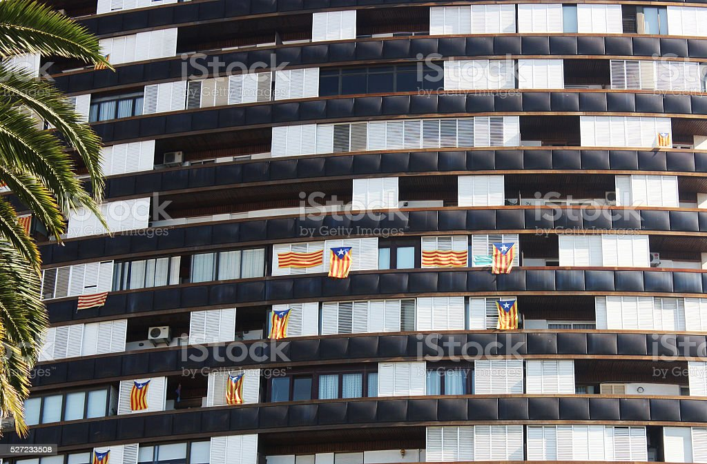 Barcelona house with flags of Catalonia stock photo