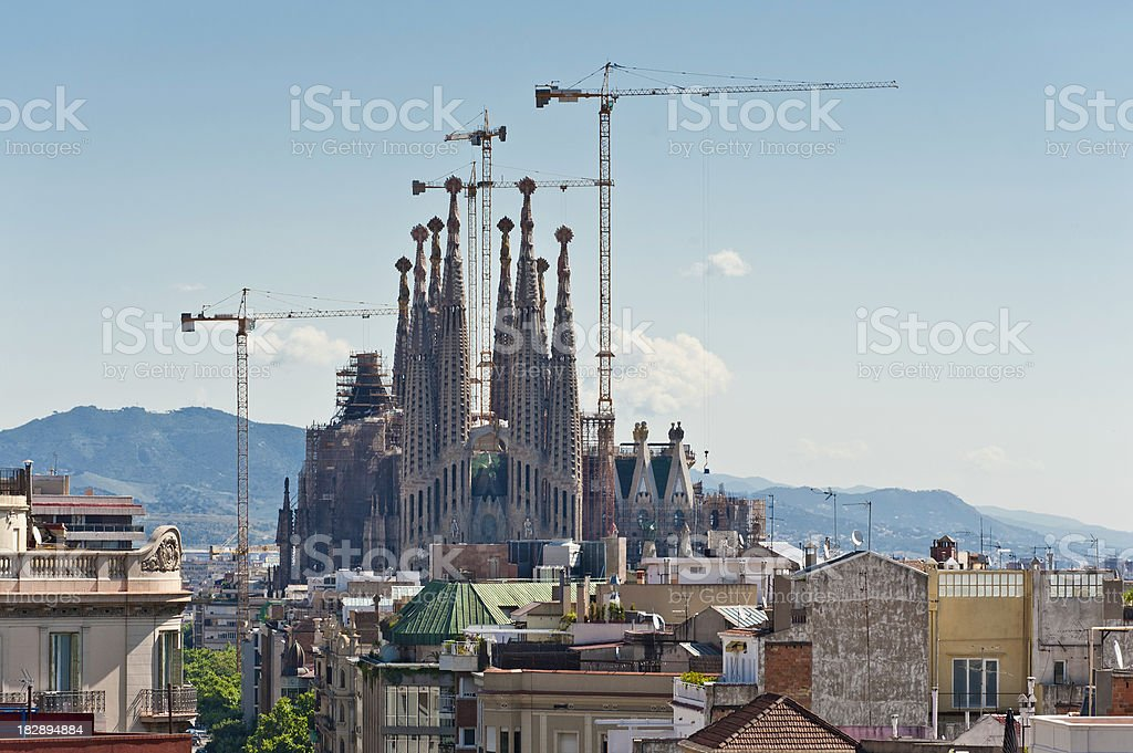 Barcelona Sagrada Familia spires construction cranes L'Eixample rooftops Catalonia Spain royalty-free stock photo