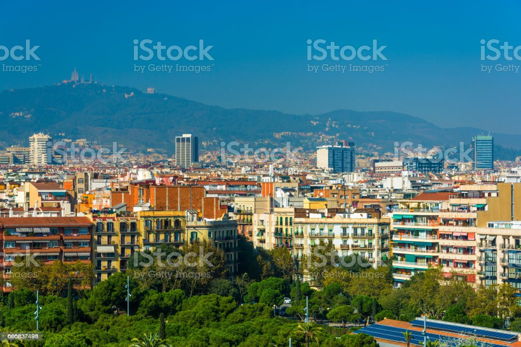 Barcelona Skyline with Mountains and Trees stock photo