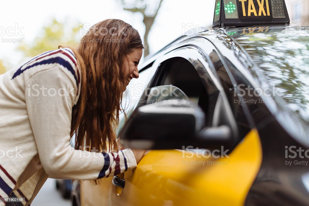 Barcelona, Woman Catching a Cab stock photo