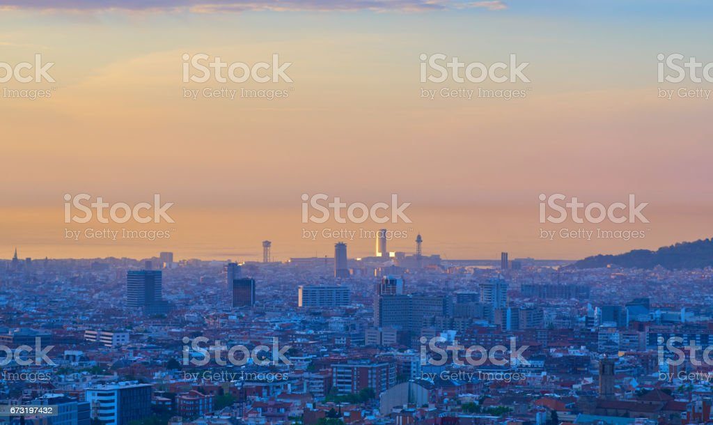 Barcelona's sunrise a clear day stock photo