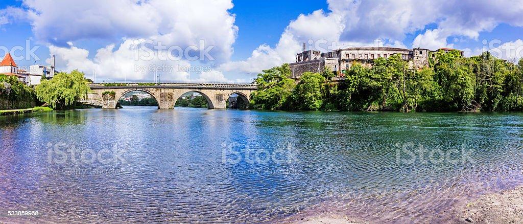 Barcelos bridge and the river Cávado stock photo