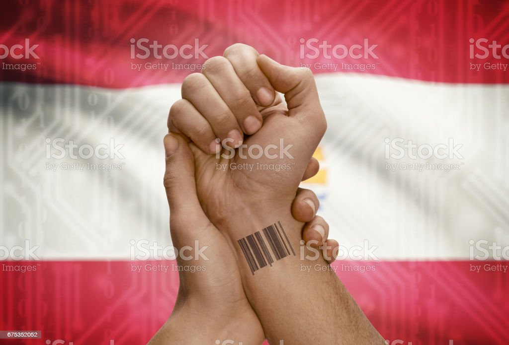 Barcode ID number on wrist of dark skinned person and national flag on background - French Polynesia stock photo