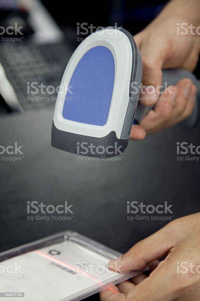 Barcode scaner is in the hands of man stock photo