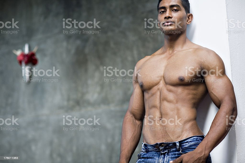 bare chested handsome young man stock photo