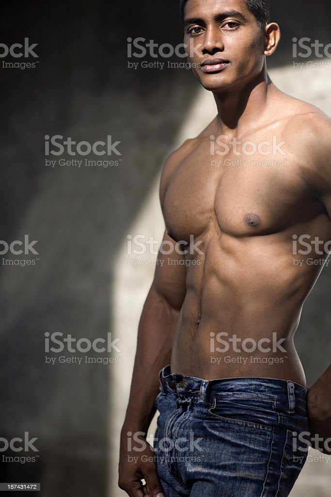 bare chested sexy portrait of a young man stock photo