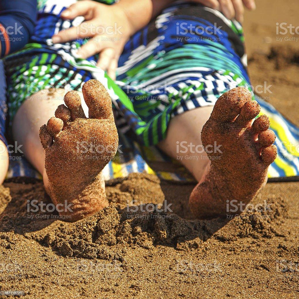 Bare feet at the beach. royalty-free stock photo