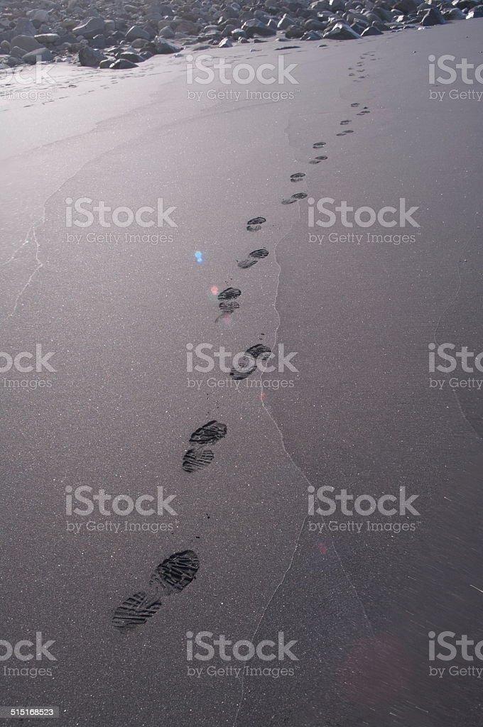bare feet black sand stock photo