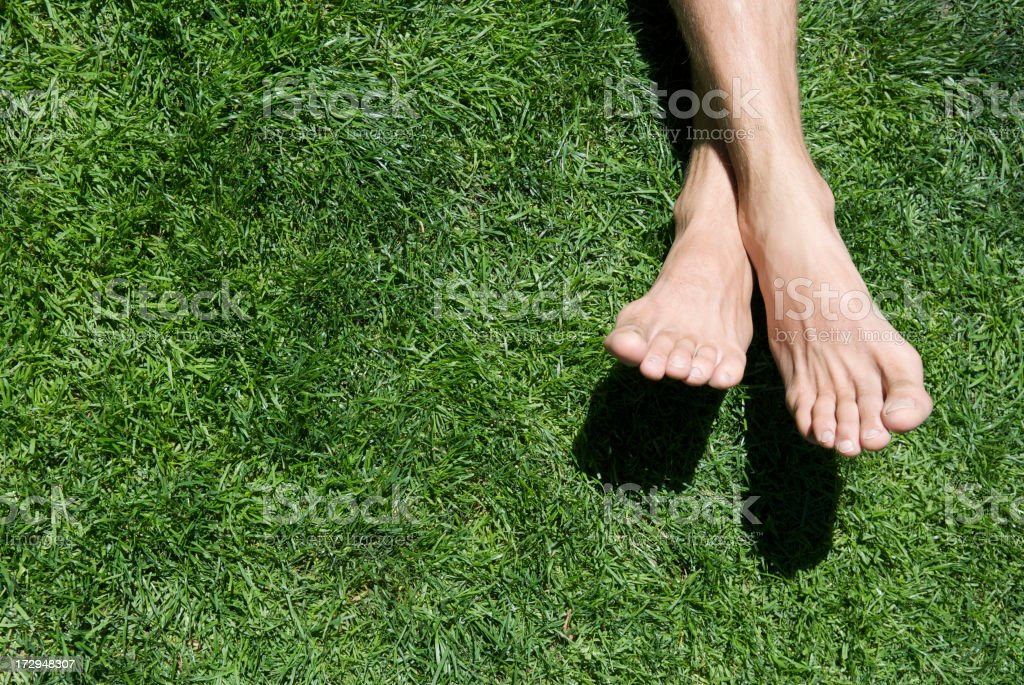 Bare Feet Green Grass Summer Relaxing stock photo