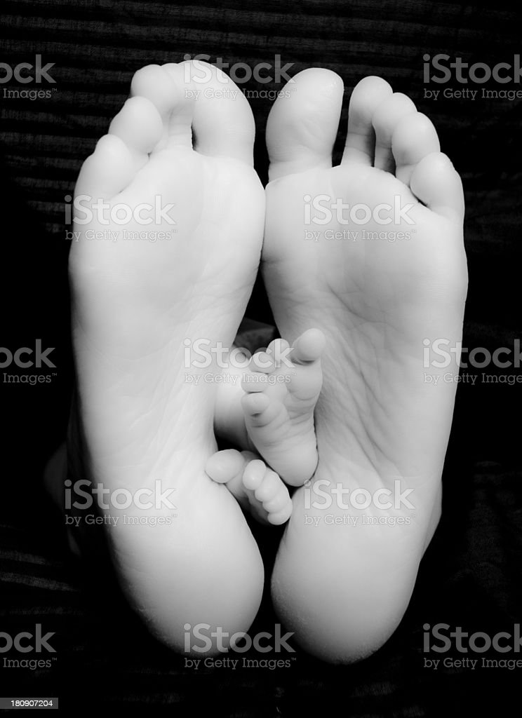 Bare Feet of Proud Mother and Newborn Baby Child stock photo