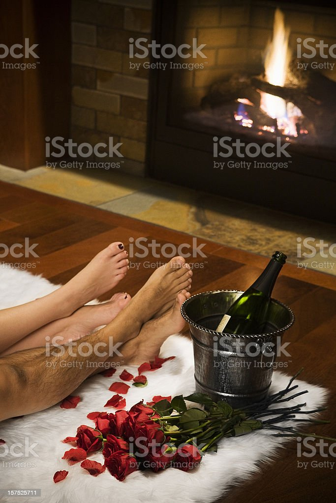 Bare Legs with Valentine Roses, Champagne and Fireplace, Copy Space royalty-free stock photo