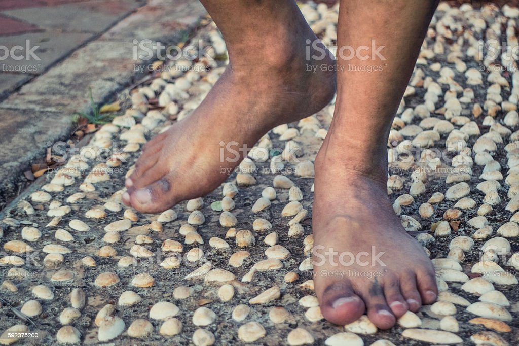 barefoot at cement stone track stock photo