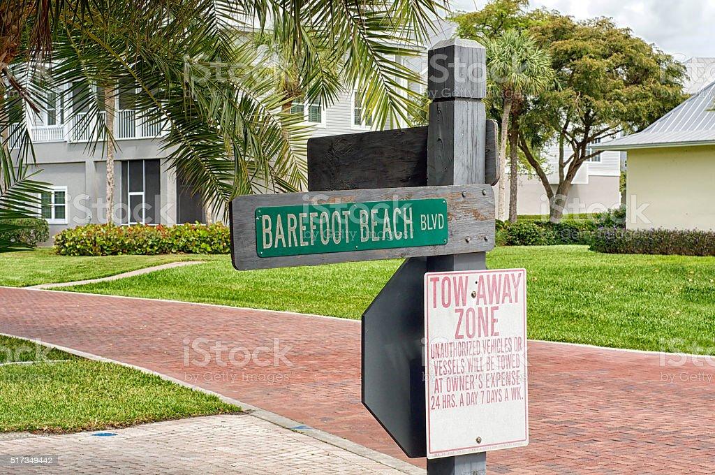 Barefoot Beach Blvd street sign stock photo