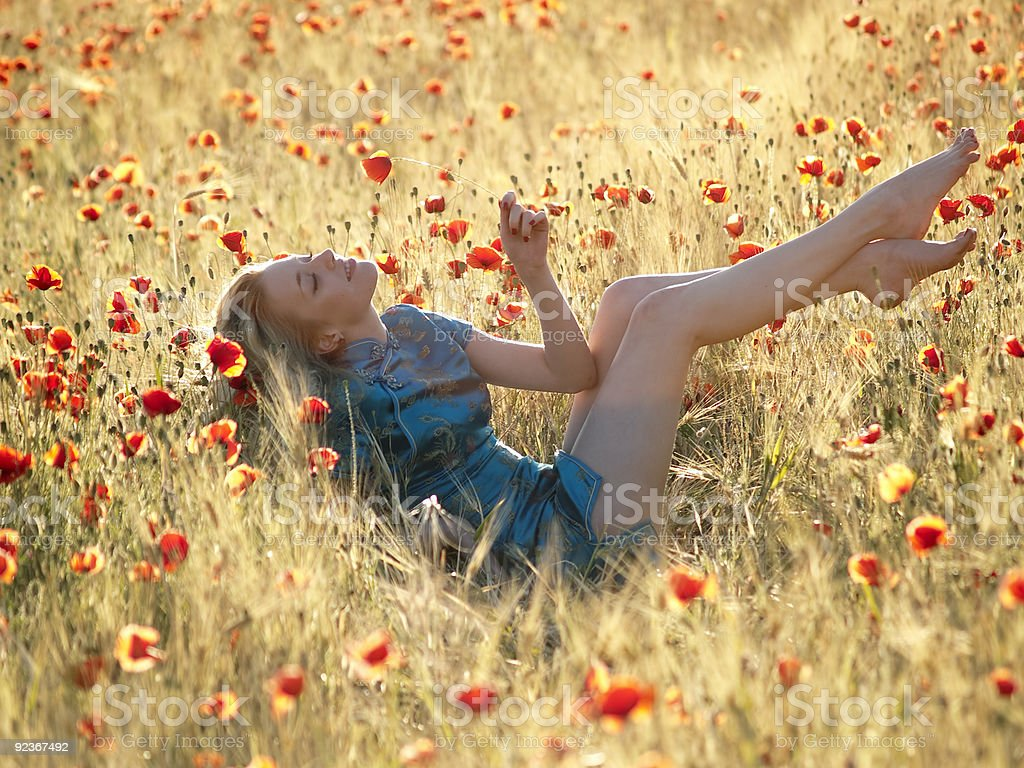 Barefoot blonde in poppies royalty-free stock photo