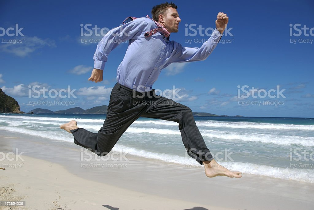 Barefoot Businessman Running on Tropical Beach royalty-free stock photo