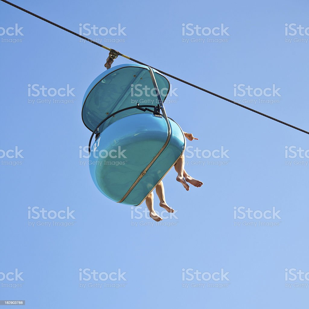 Barefoot Friends at the Beach Ride in Sky Lift Chair royalty-free stock photo