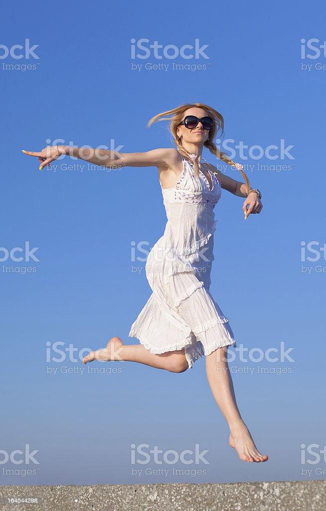Barefoot girl in sunglasses on open air royalty-free stock photo