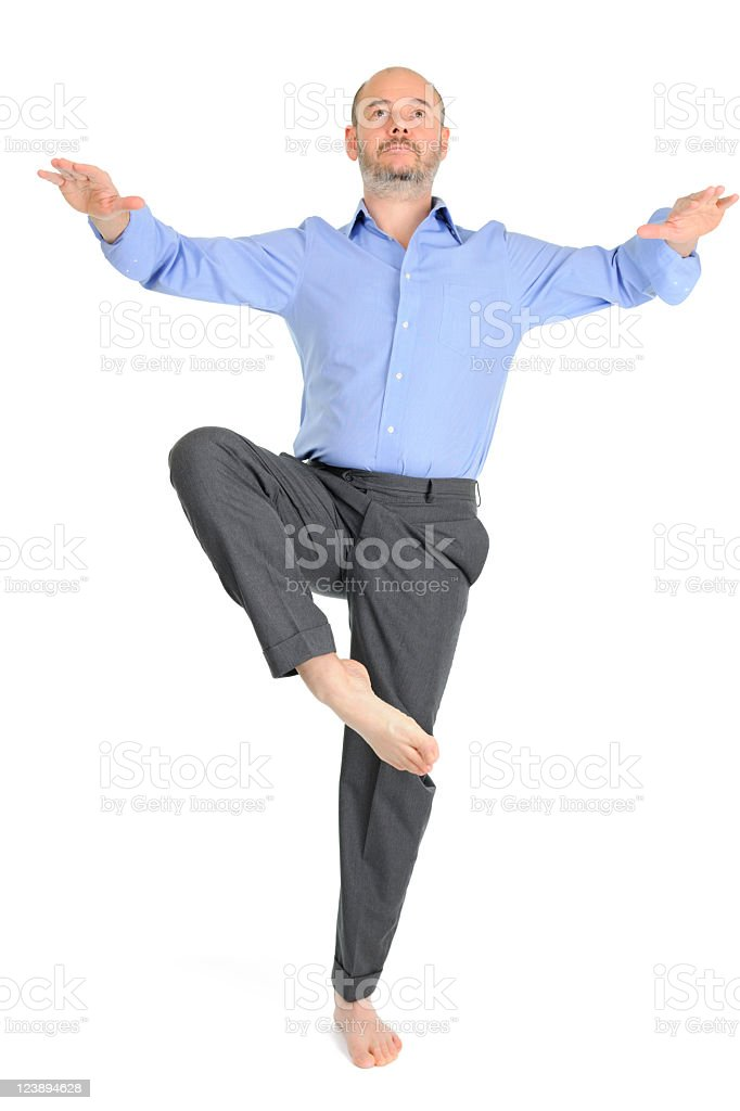 Barefoot Mature Businessman Attempting to Balance on One Foot royalty-free stock photo