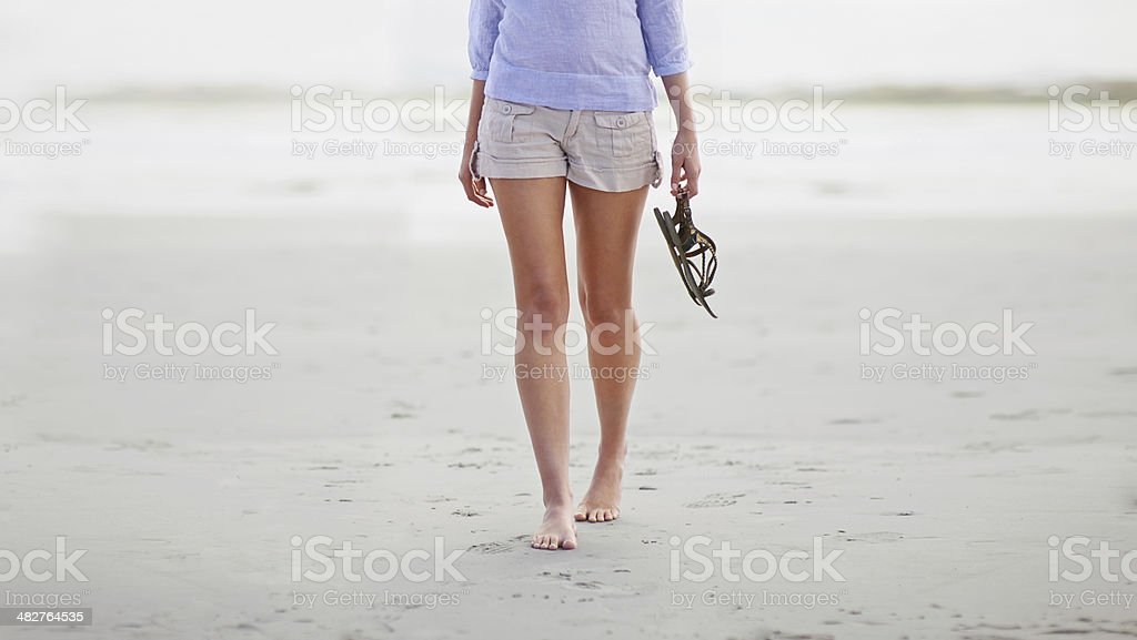 Barefoot on the beach stock photo