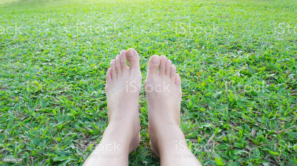 Barefoot on the grass Feel free to relax stock photo