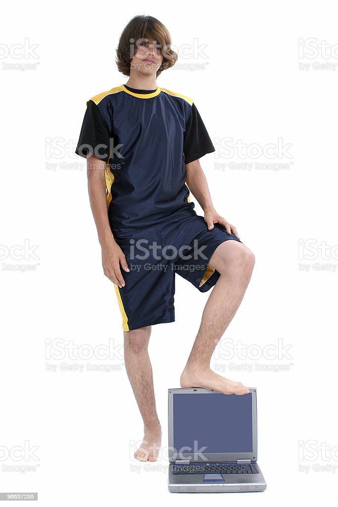 Barefoot teen Boy Standing with Laptop Computer Over White stock photo