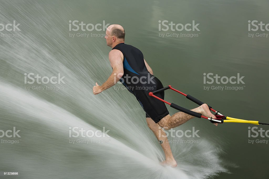 barefoot water skiing backwards in toe hold royalty-free stock photo