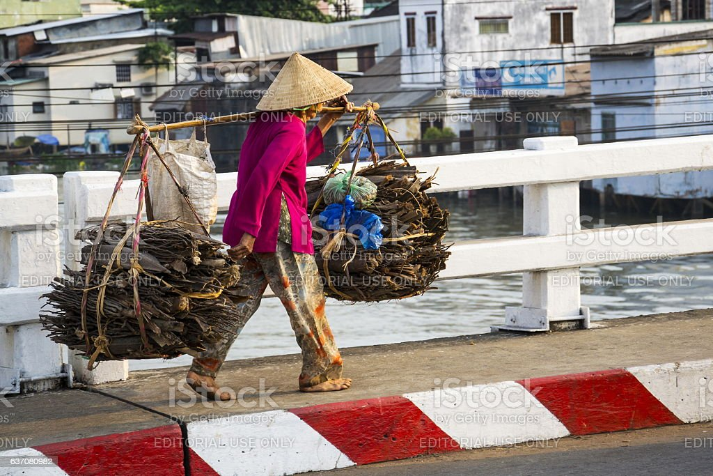 Barefoot woman on busy street in My Tho, Vietnam stock photo