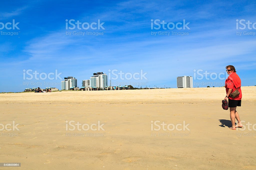 barefoot woman on the dunes stock photo