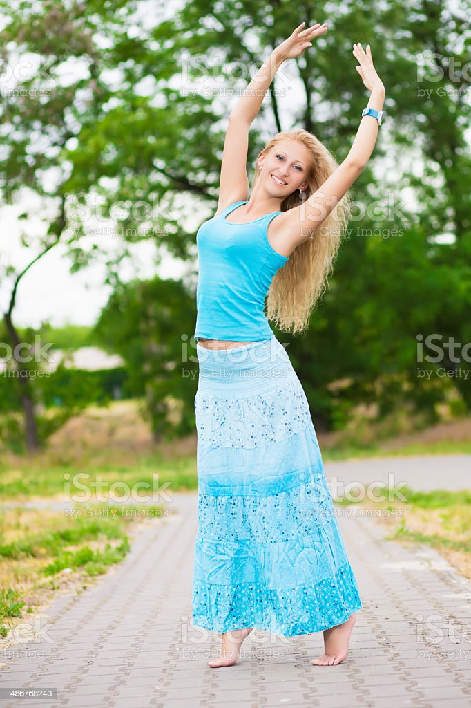 Barefooted blond woman stock photo