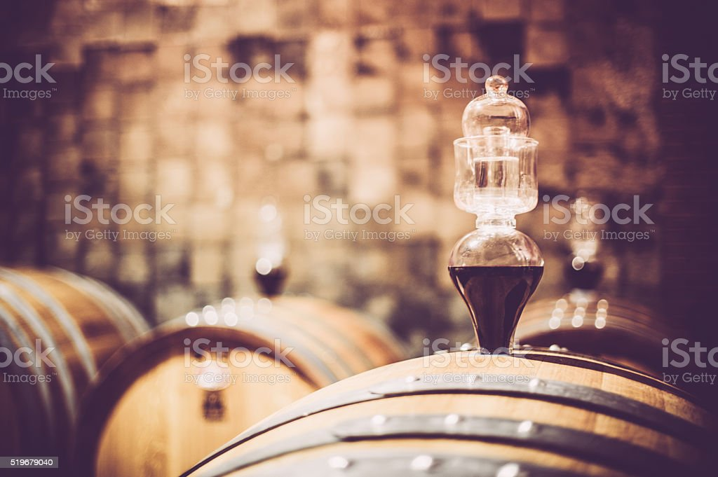 Barells with boiling peg in wine cellar stock photo