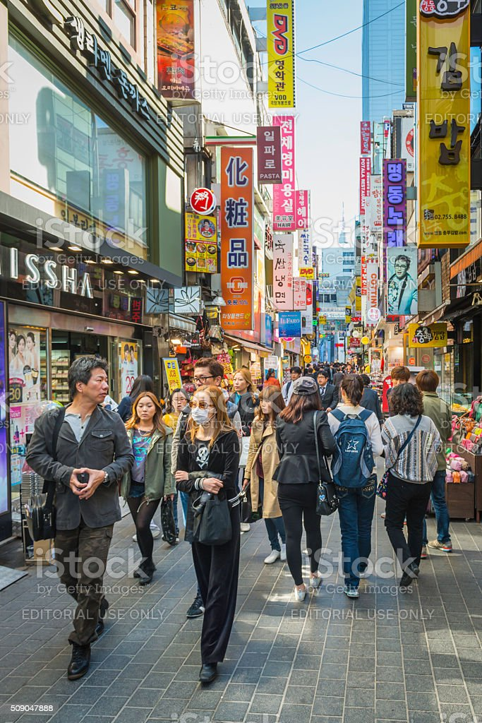 Bargain hunters in colourful crowded shopping street downtown Seoul Korea stock photo