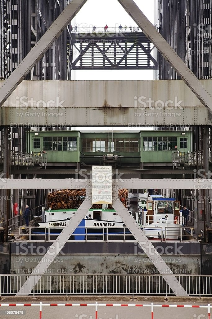 Barge and boats inside the Niederfinow boat lift stock photo