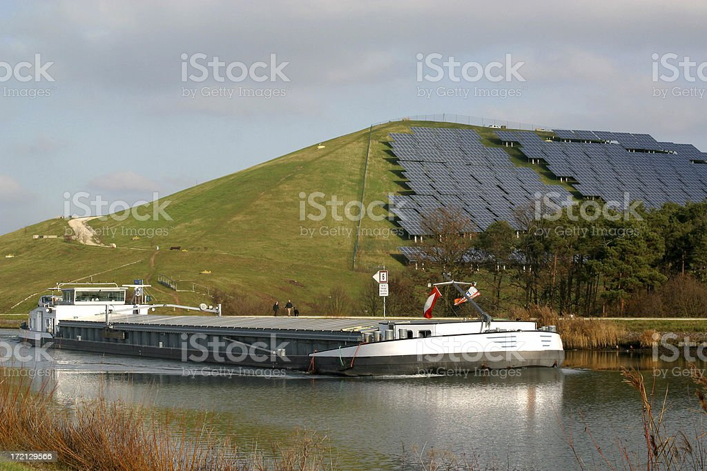 barge and solar power station stock photo
