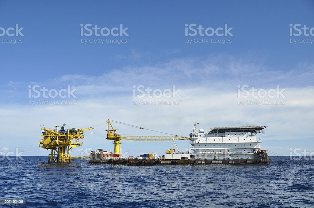 barge and tug boat in open sea royalty-free stock photo