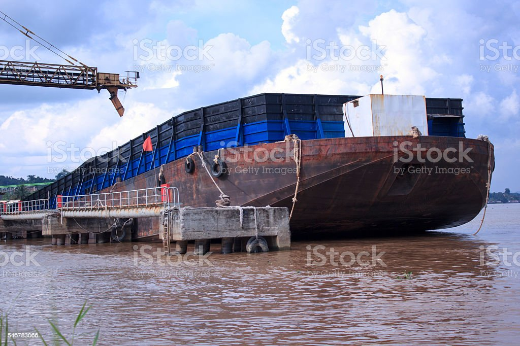 Barge at Jetty stock photo