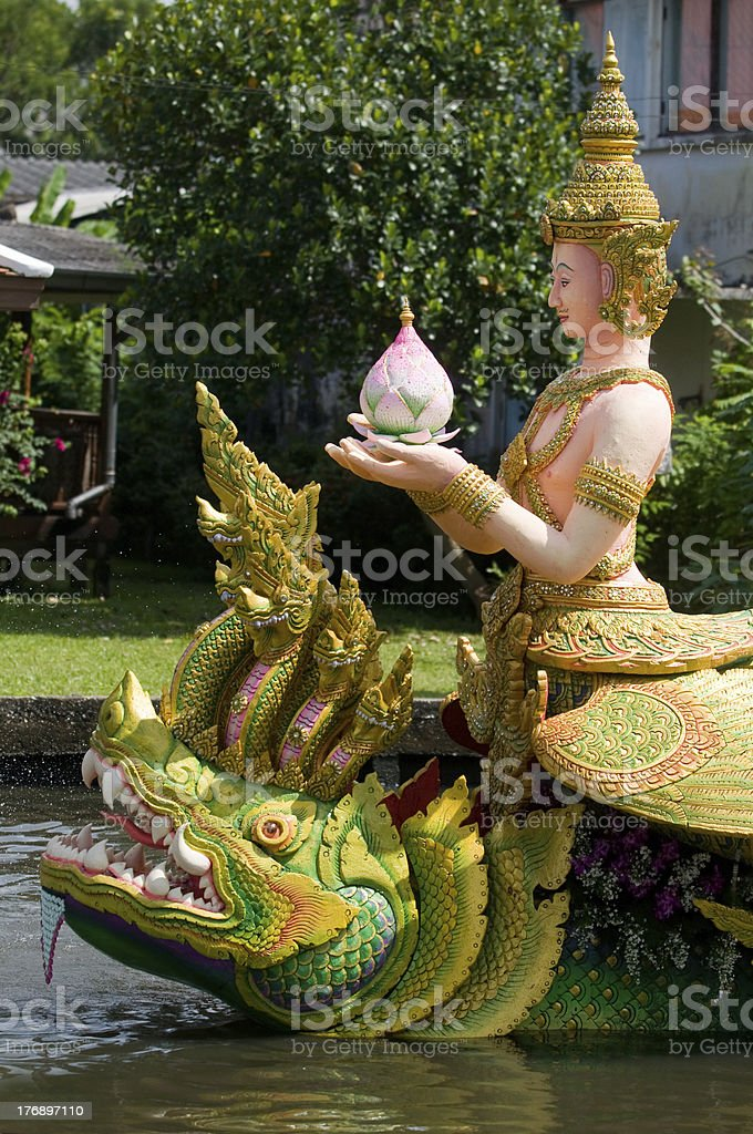 Barge decorated with religious symbols in Thailand stock photo