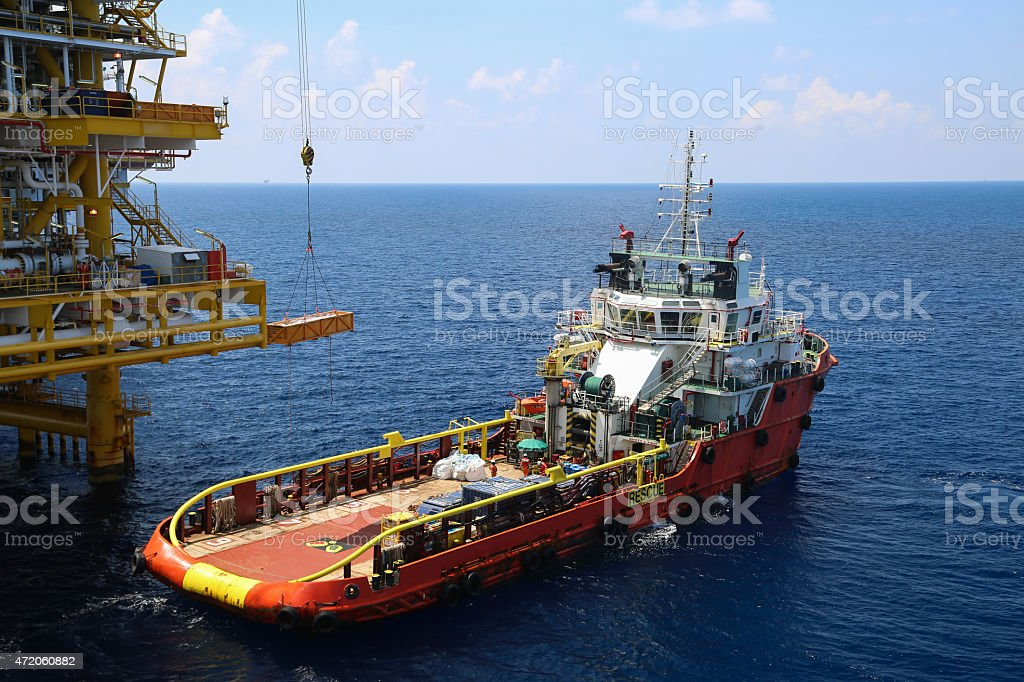 A barge docking on to an offshore construction platform stock photo
