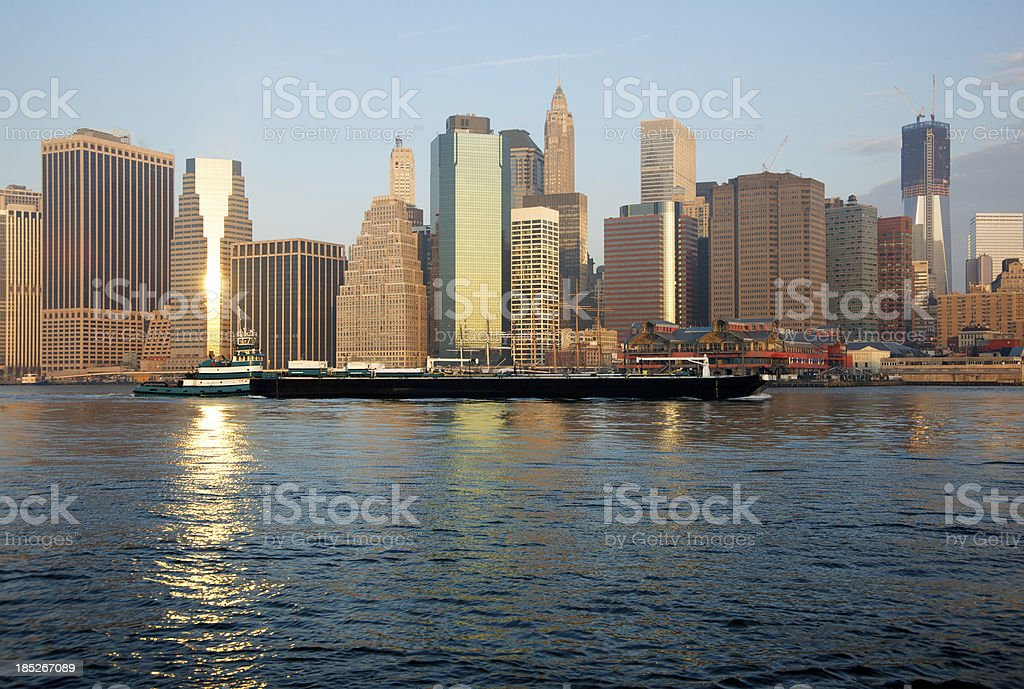 Barge in East River, NYC Financial District, Sunrise royalty-free stock photo