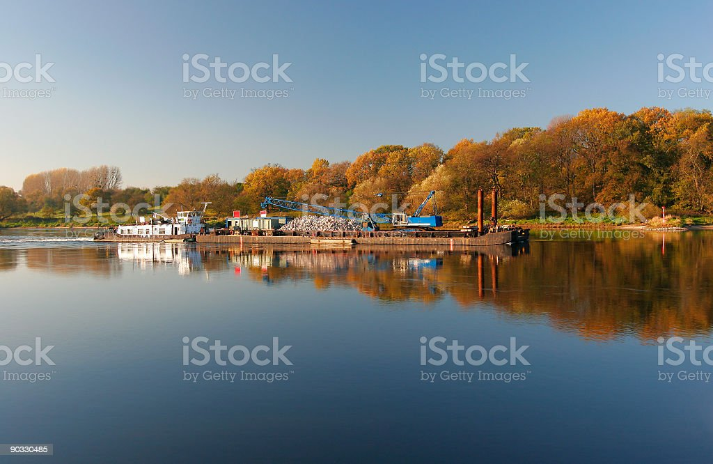 Barge  on Autumn River royalty-free stock photo